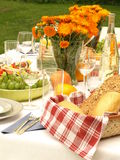 Feast in the garden. Laid table for feast in the open air royalty free stock photo