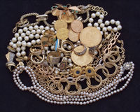 A feast of golden jewels and coins Royalty Free Stock Photo