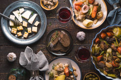 Feast with kasul, cheese, bread, olives and wine stock image