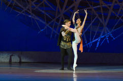 Feast on pointe. DNIPROPETROVSK, UKRAINE - MAY 30: Dancers Catherine Shmigelsky and Alexei Chorich perform SPARTACUS at State Opera and Ballet Theatre on May 30 royalty free stock images