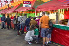 Feast of San Gennaro. Sao Paulo, Brazil, October 06, 2016. people on street and kiosks in feast of San Gennaro in the neighborhood of Mooca in Sao Paulo royalty free stock image