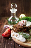 Feast still life. Bread with bacon, onion and other greens royalty free stock images