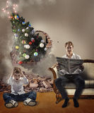Feast time surprise,pine tree brakes the wall, surprised son and busy father, do not forget-is time for holiday celebration Royalty Free Stock Photos