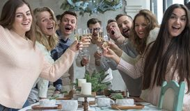 Feast with Young People. New Year`s Concept. Christmas. Winter royalty free stock photography