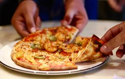 Feasting on Pizza Royalty Free Stock Photography