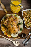 Feasting - stuffed roast chicken with herbs. Mashed potatoes with oregano leaves and homemade stuffing with herbs, freshly squeezed orange juice, fresh fruits Stock Photography
