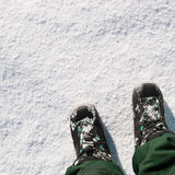 Feat on the snow. Conceptual white snow background. 1 Royalty Free Stock Photos