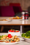 Feat and spinach quiche. Feat and spinach layered quiche served with tomato sauce, cherry tomatoes and roast potatoes Stock Photos