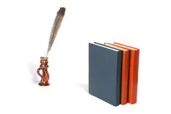 Feather and books Stock Photography