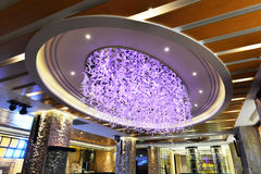 Feather ceiling lighting. Large luxury feather ceiling lighting in hotel hall, low angle royalty free stock photo