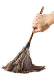 Feather Duster. Hand holding a ostrich-feather duster isolated on white Royalty Free Stock Photos