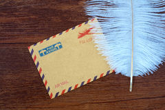 Feather and envelope on the table Royalty Free Stock Photos