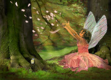 Feather Fairy. Little girl dressed like a fairy in the woods Stock Images