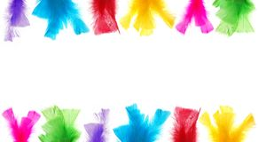 Feather frame banner. Colorful feathers framing white background Royalty Free Stock Image