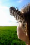 Feather girl Stock Photo