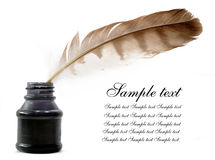 Feather and ink bottle. Isolated on white Royalty Free Stock Images