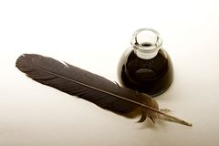 Feather and ink bottle Royalty Free Stock Photo