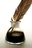 Feather and ink bottle Stock Image