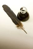 Feather and ink bottle Stock Photography