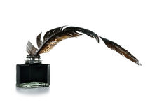 Feather and ink bottle Royalty Free Stock Image