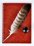 Feather with ink bottle and workbook Royalty Free Stock Images