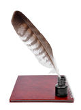 Feather with ink bottle Stock Images