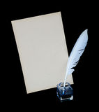 Feather, ink and sheet of old paper Stock Images