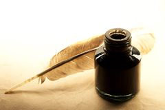 Feather and inkpot Royalty Free Stock Photo