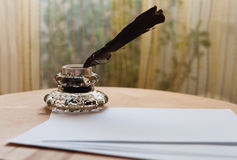 Feather and inkwell Stock Photos