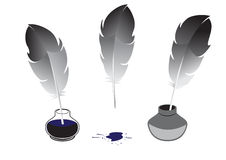 Feather and inkwells Royalty Free Stock Image