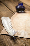 Feather lying on vintage letter Royalty Free Stock Images