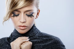 Feather Makeup. Beautiful blond woman with artistic feather makeup Royalty Free Stock Images