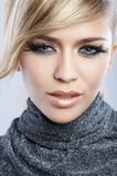 Feather Makeup. Beautiful blond woman with artistic feather makeup Royalty Free Stock Image