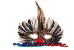Feather mardi gras mask with colorful beads. Isolated feather mardi gras mask with colorful beads on white background royalty free stock photography