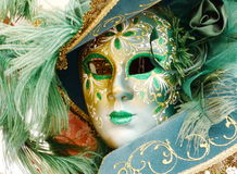 Feather mask from Venice. Green feather mask close-up in Italy Royalty Free Stock Images