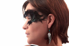 Feather masked woman earring Royalty Free Stock Photos
