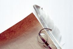 Feather Near Paper Stock Photos