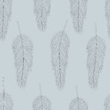 Feather pattern. Tender seamless vector pattern with feathers on grey background Royalty Free Stock Photo