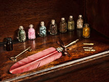 Feather pen and jars Stock Images