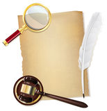 Feather pen, old papirus, gavel and magnifying glass Royalty Free Stock Photo