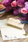 Feather pen. Old postage with fresh  flowers  and blue  feather pen Stock Photography