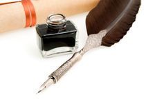 Feather quill ,inkwell and parchment roll Stock Photo