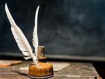 Feather quill pen and ink bottle stock photography