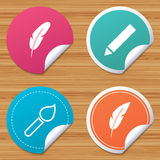 Feather retro pen signs. Brush and pencil icons. Royalty Free Stock Photos