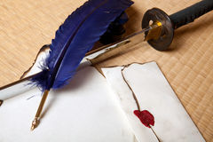 Feather sword and letter Royalty Free Stock Image