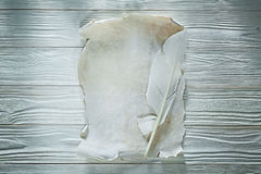 Feather vintage clean paper sheet on wooden board Royalty Free Stock Photo