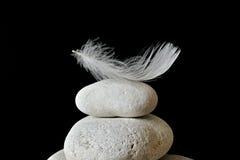 Feather. White feather on white stone stock photos