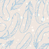 Feathers. Seamless pattern with feathers falling on a beige background Stock Photos