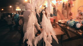 The feathers accessory hanging on the display. It has different colors like black gray and white stock video