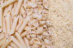Feathers, bows pasta or macaroni and vermicelli background, text Stock Photography